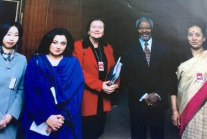 Margaret Reynolds with Kofi Annan and others, working for peace.